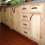 Kitchen cabinets w/ rustic pulls.